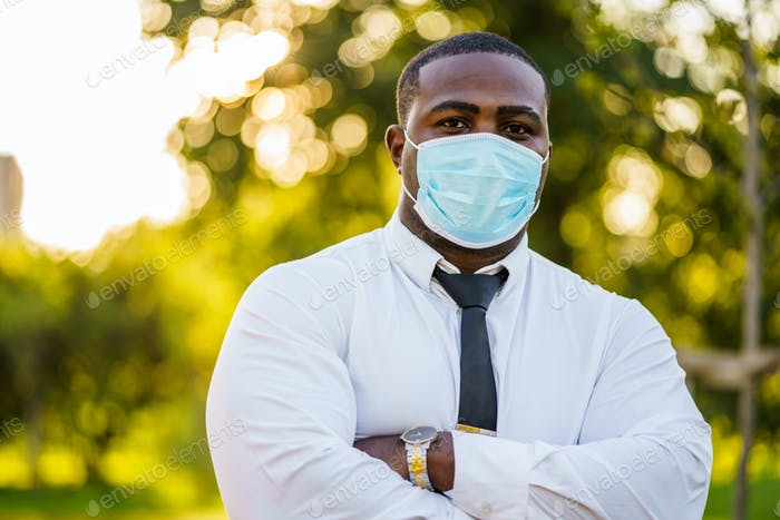 Businessman with protective mask