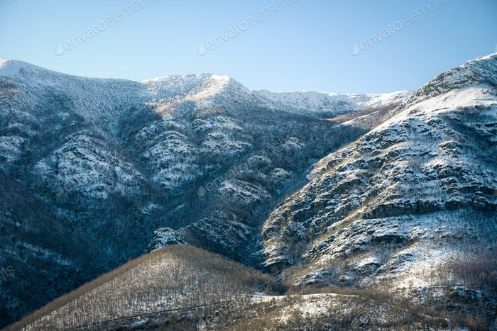 Snowy north slope of a mountain range