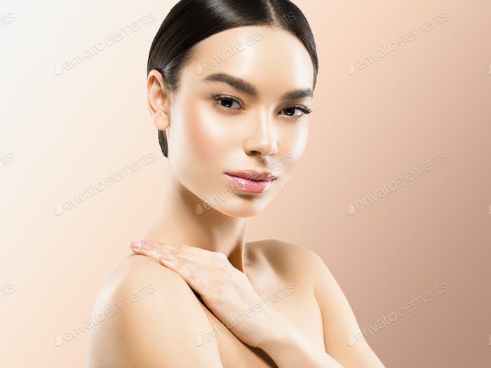 Woman cosmetic closeup beauty portrait with hands healthy care skin hair over beige color background