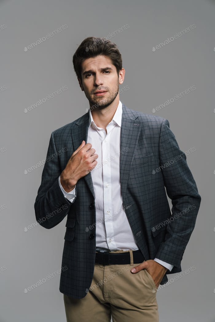 Photo of respectable confident businessman posing and looking at camera
