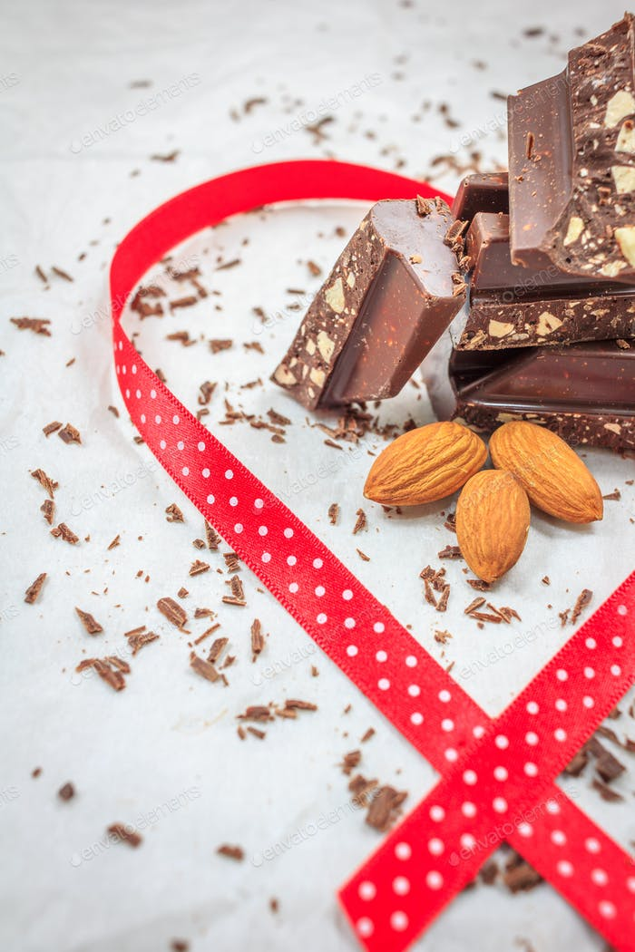 Dark chocolate and almonds decorated with red ribbon
