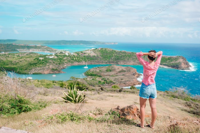Young woman enjoying breathtaking views of beautiful landscape