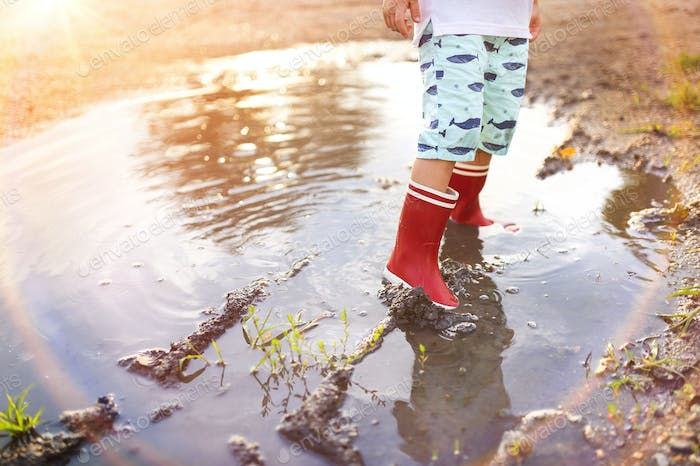 Boy in a puddle