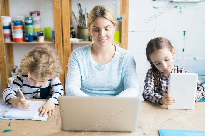 Woman at work with children