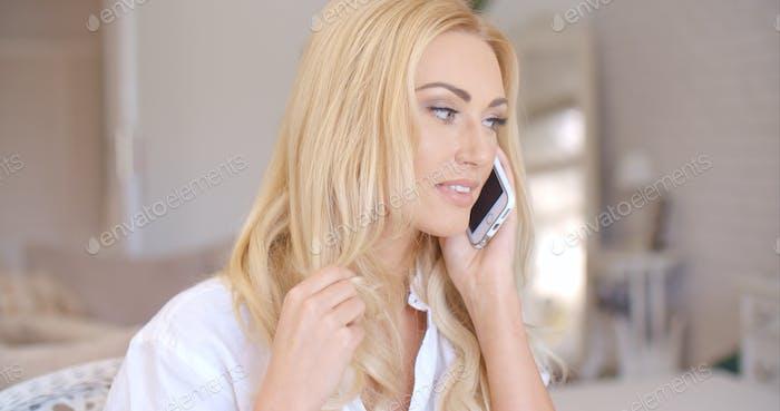 Smiling Blond Female Talking through Phone