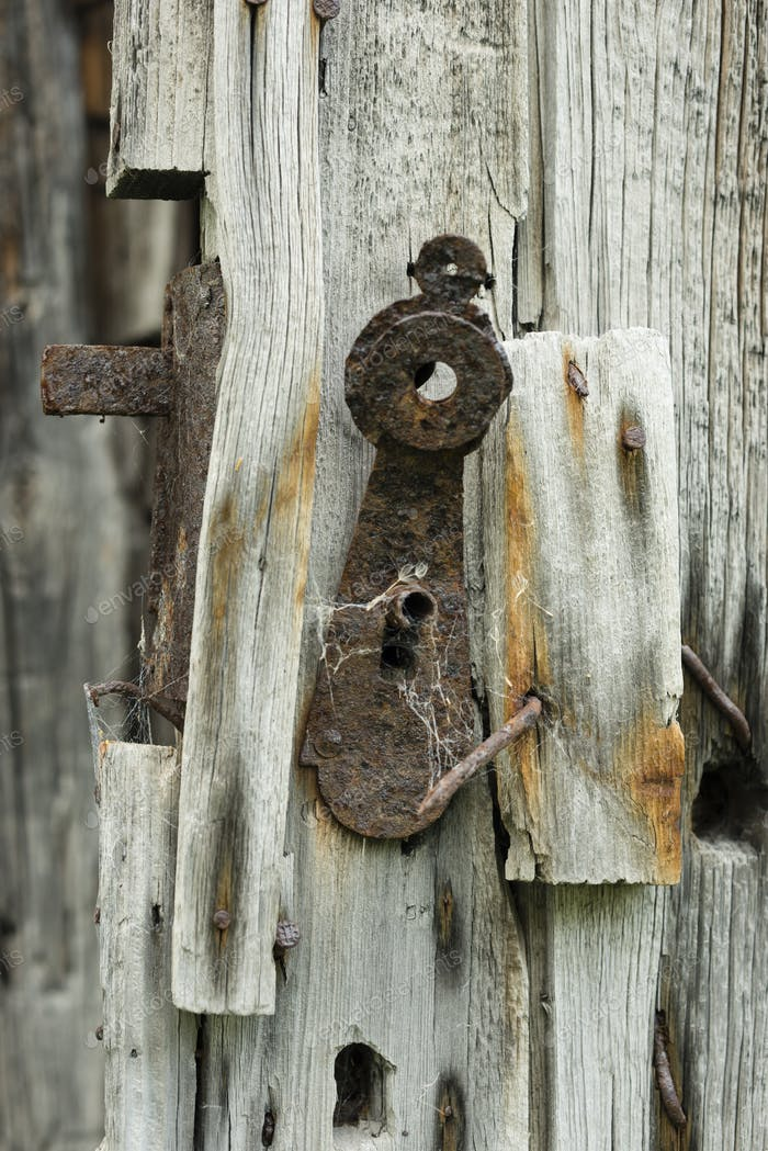 Old rusty lock in a mountain wooden cabin
