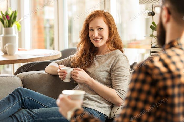 Smiling woman drinking tea