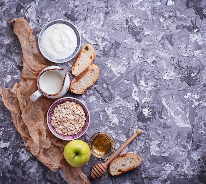 Oat, milk, yogurt, bread and apple.