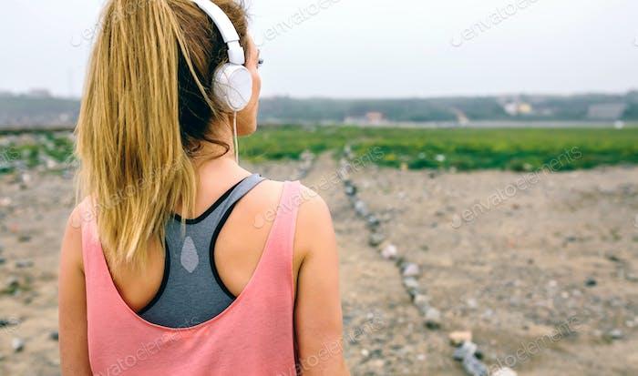 Young sportswoman watching the way