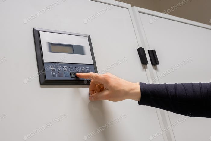 Professional Engineer Adjusting Air Conditioner In Datacenter