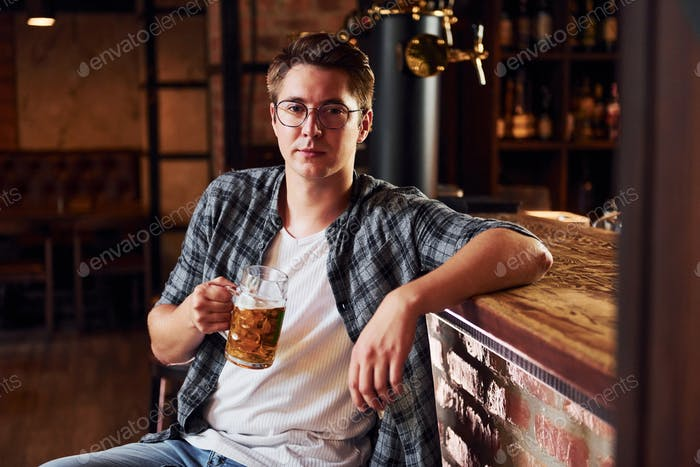 One person. Man in casual clothes sitting in the pub