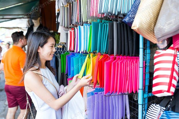 Woman shopping in weekend market
