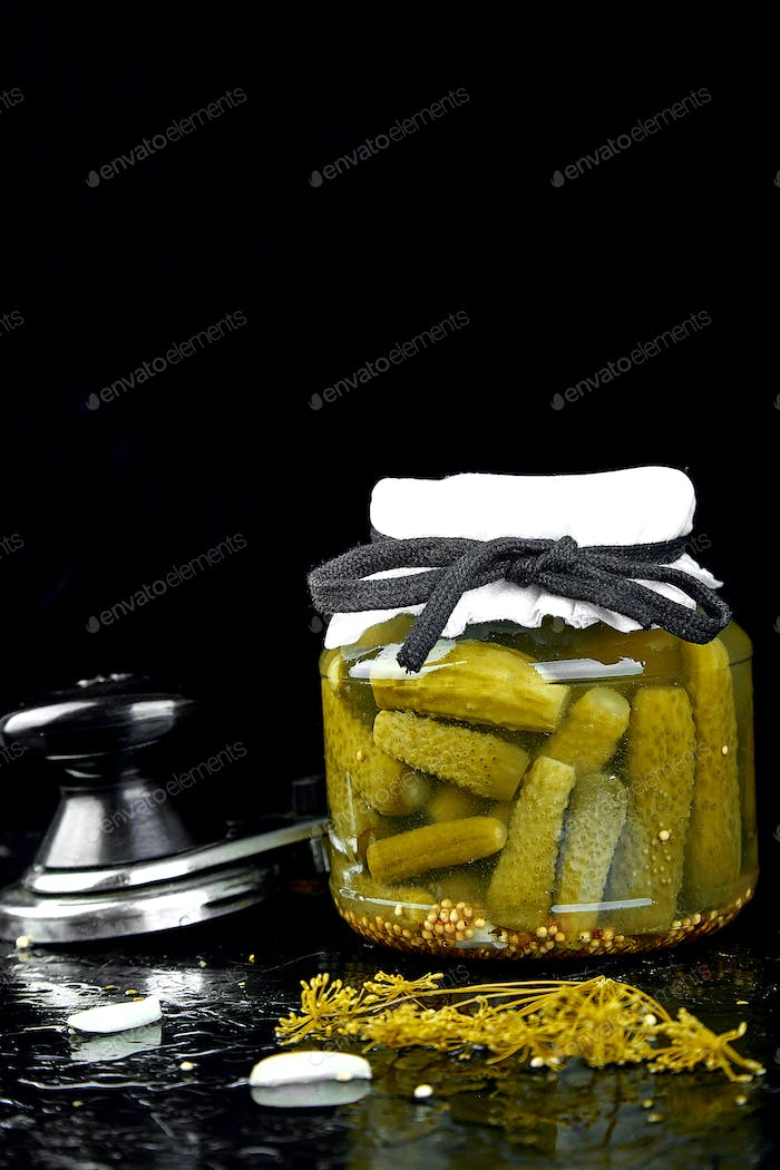 Canned cucumbers in a metal pan.