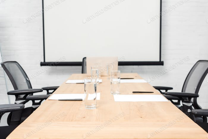 interior of empty conference hall with blank presentation board