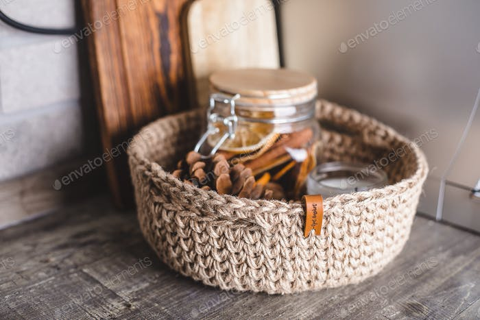 Eco friendly jute knitted baskets with decor, candle. Zero waste concept. Decor and interior