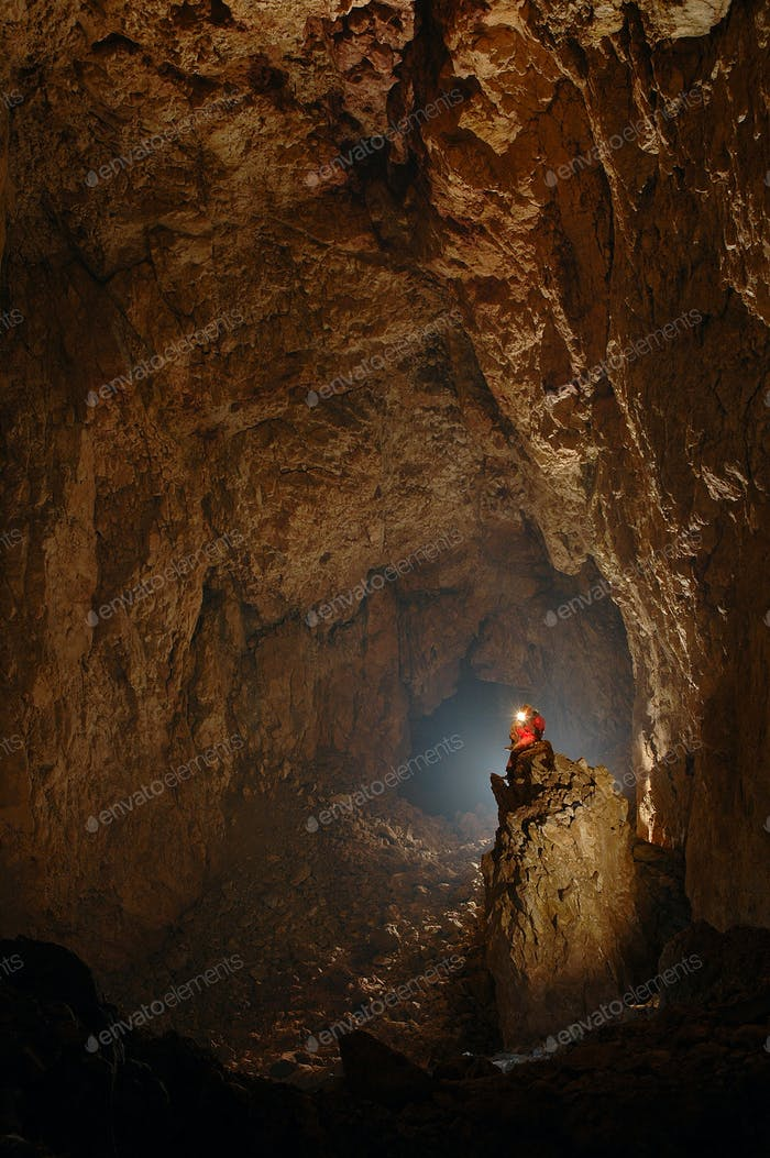 Monumental cave chamber with a spelunker