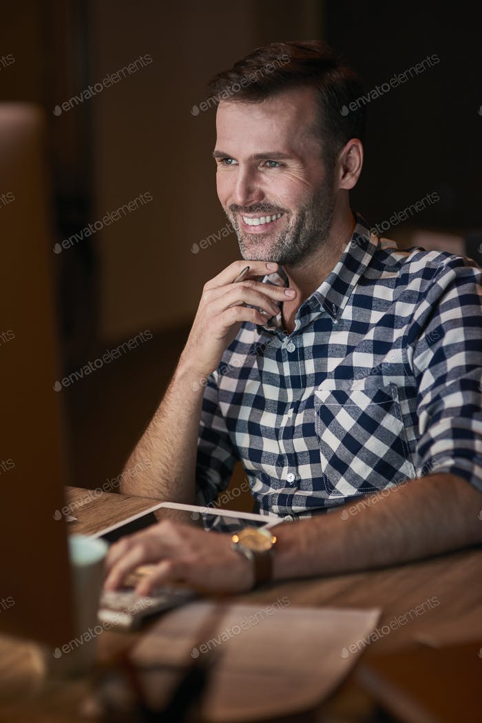 Man typing on computer keyboard in home office