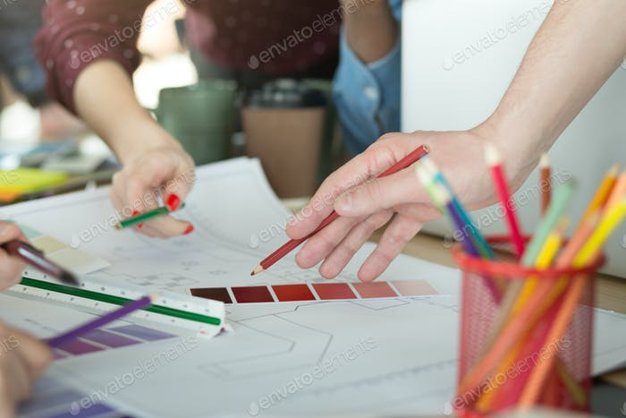 Creative designers working with color samples for selection