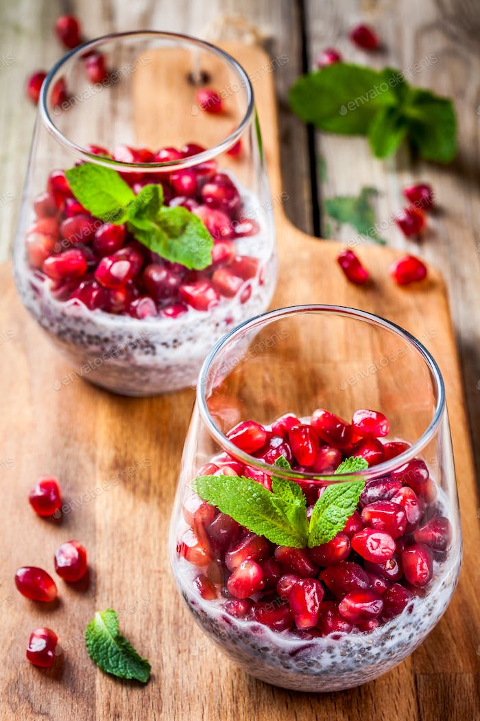 chia pudding with pomegranate seeds and mint
