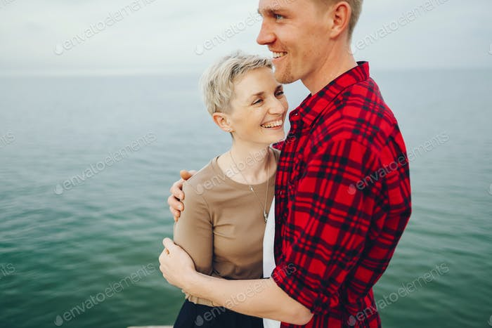 happy couple near ocean