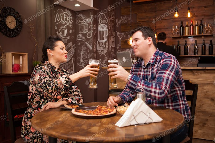 Lovely couple in new pub enjoying their beer