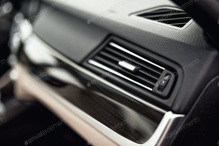Car ventilation system with adjustment buttons and details of modern car