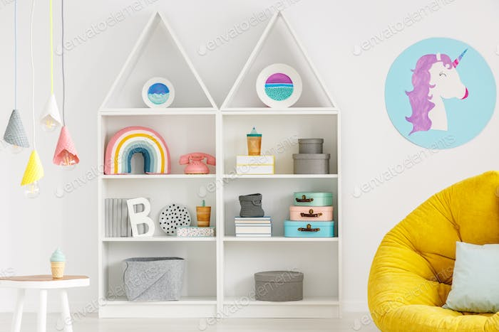 Rainbow, telephone and boxes on white shelves, unicorn poster, l