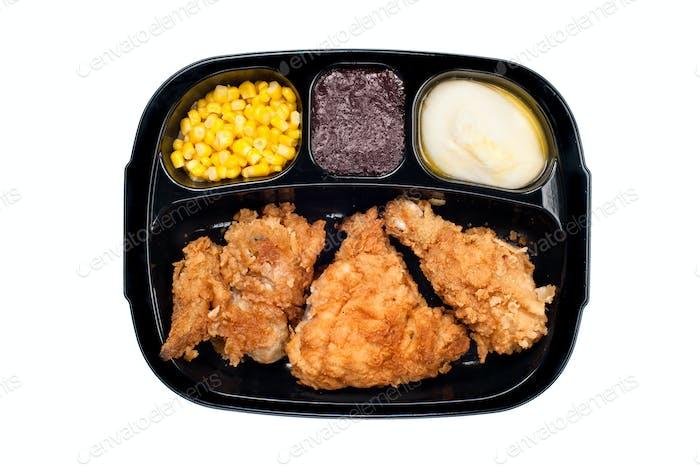 Chicken TV dinner in plastic tray