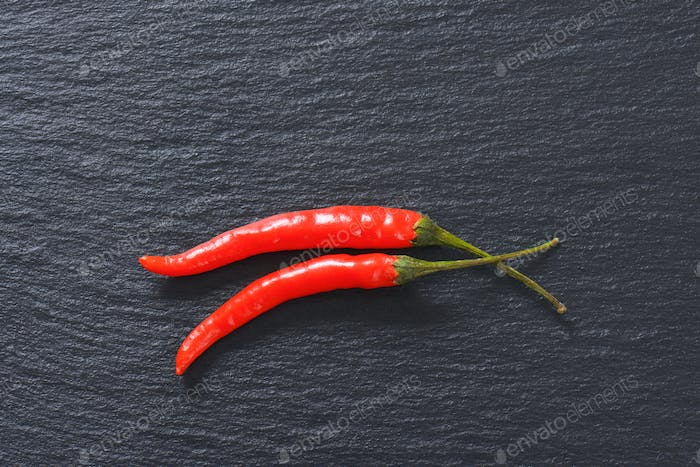 Red chili peppers on slate board