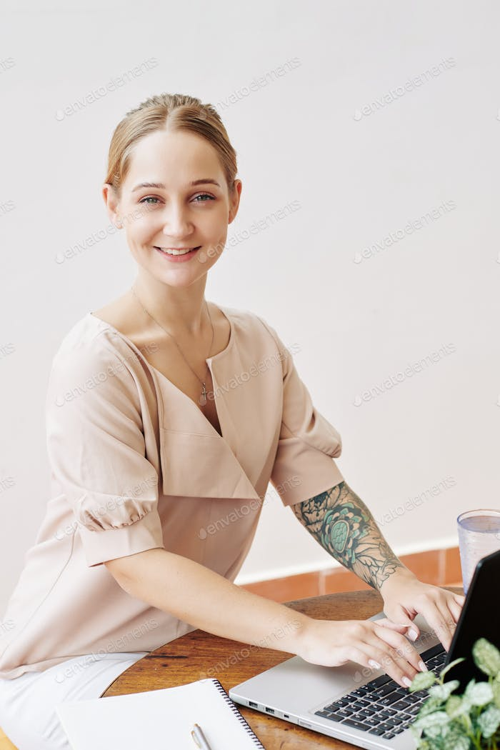 Cheerful Woman Working In Office