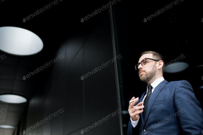 Businessman having smoke break