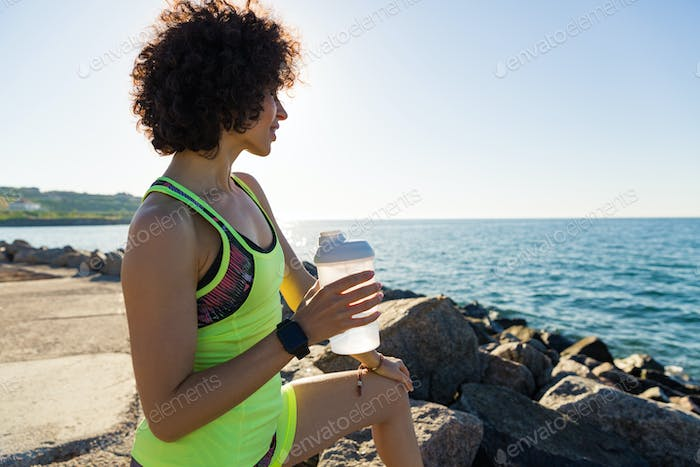 Thumbnail for Young fitness woman resting after jogging