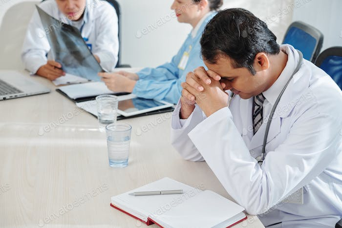Stressed and tired physician