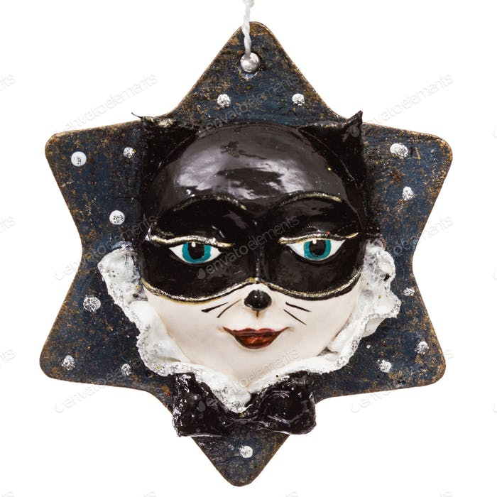 Festive decoration in the shape of a cat mask, isolated on white
