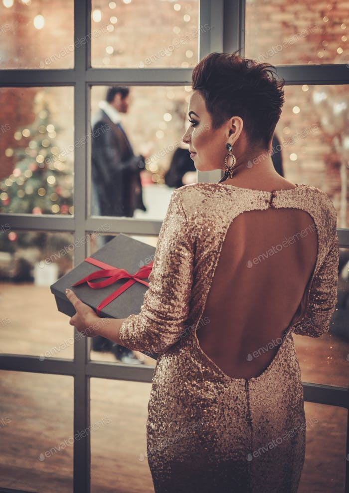 Woman carying box with Christmas present