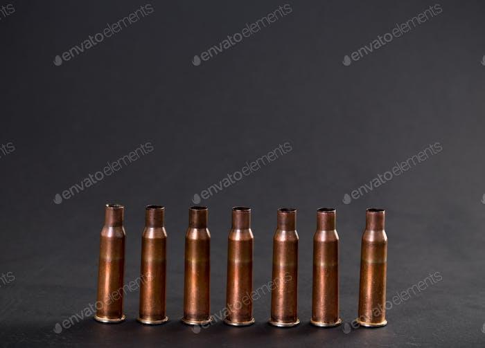 Empty rifle cartridges.