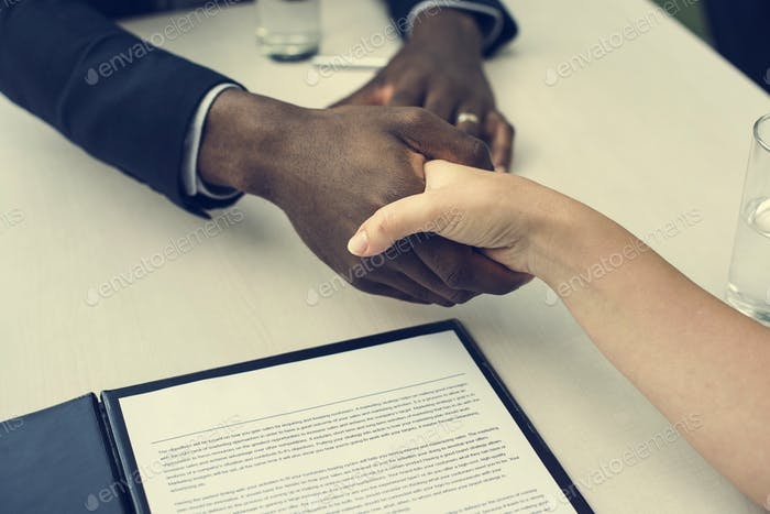 Business Contract Documents Handshake Concept