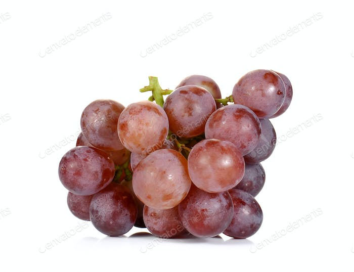Fresh red grapes on white background.