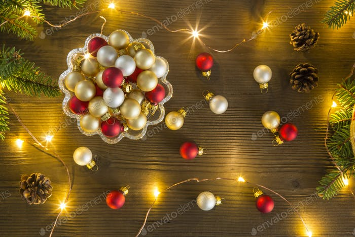 Refined Christmas composition seen from above with Christmas balls in a glass cake stand