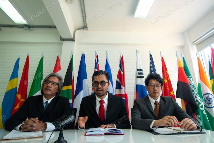 Businessmen are negotiating international trade.