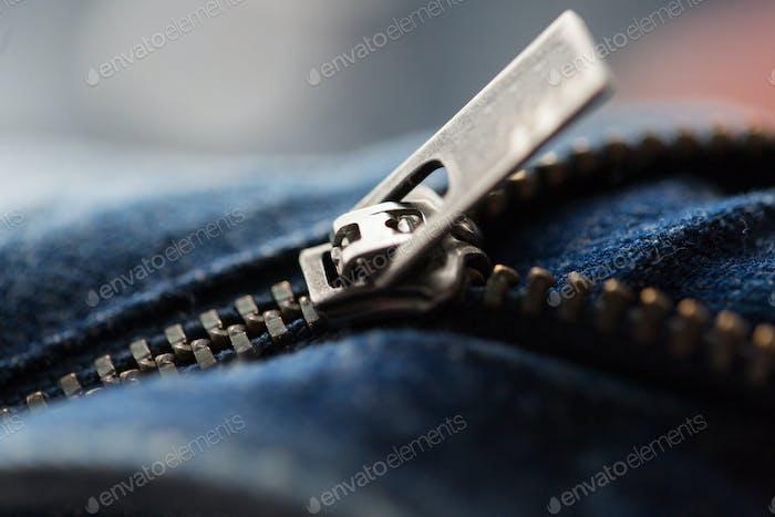 close up of denim item or jeans zipper