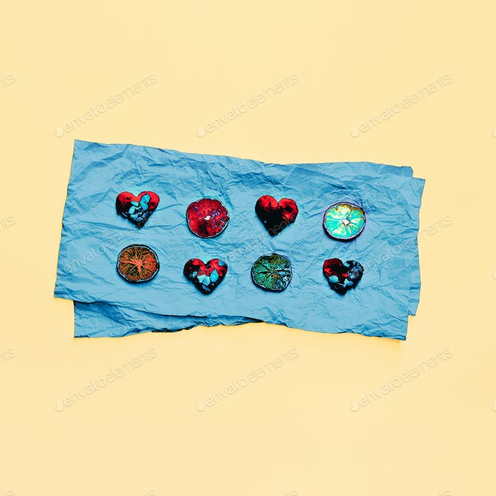 Hearts and lemons on blue paper. design Photo