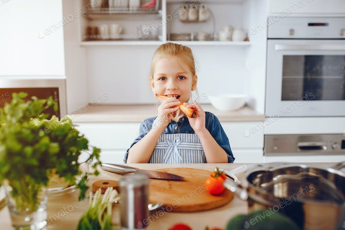 little girl in a kitchen