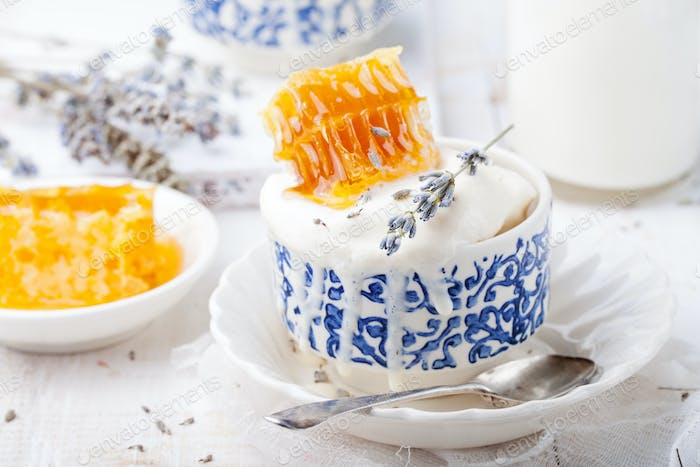 Ice Cream with Honey and Lavender in Bowls. White Background.