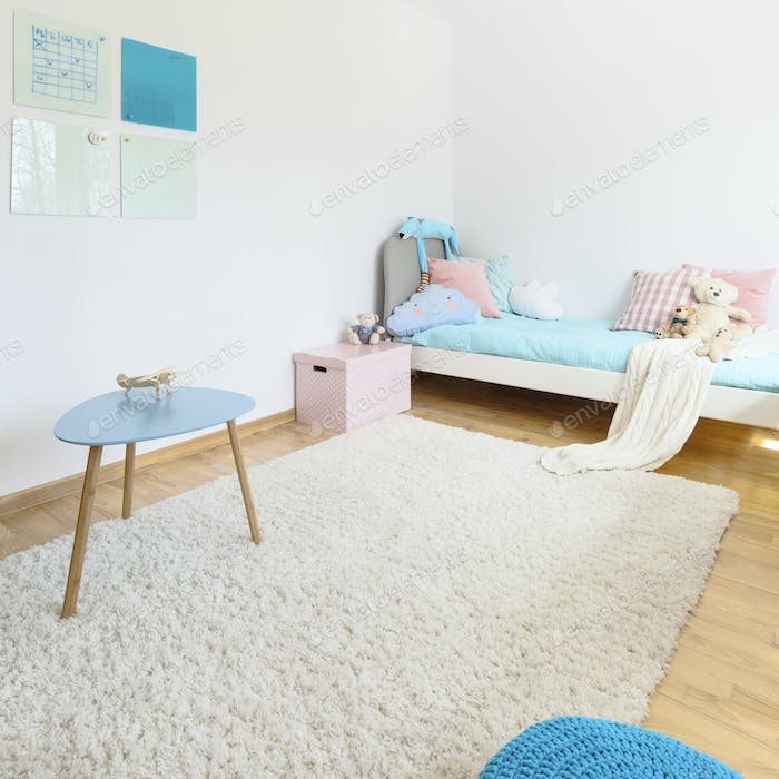 Bedroom with white fluffy carpet