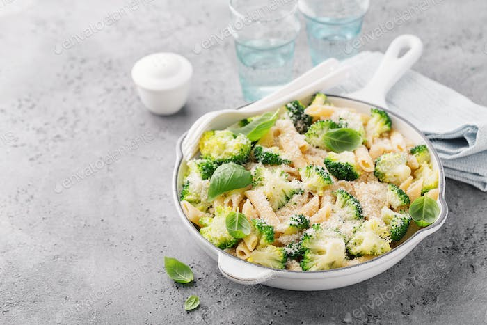 Tasty pasta penne with broccoli and cheese