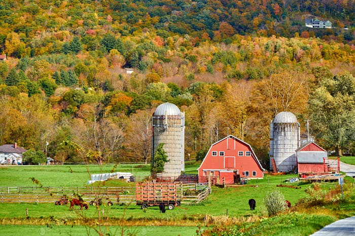Farm with red barn and silos in Vermont
