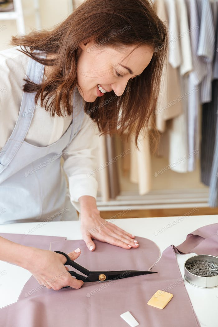 Woman using scissors to cut fabric