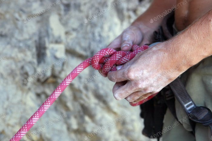 Climber's hands close-up. Mountain climbing elements