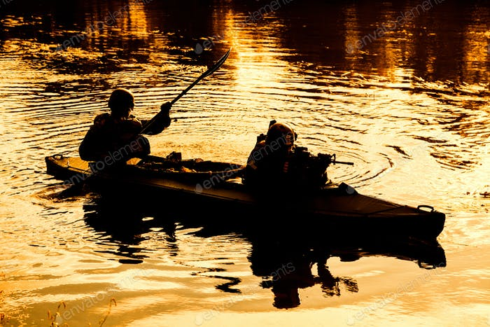 Militants in army kayak